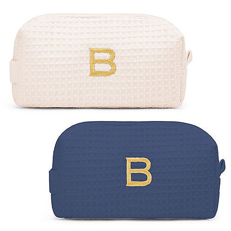 waffle cosmetic bags in navy and ivory