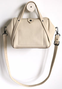 plum frrry bag. champagne colour. beautiful leather. strap. elegant.