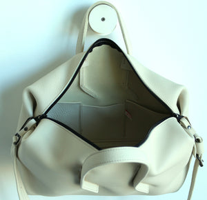 Wednesday frrry bag. Champagne colour. open view. three inside pockets.
