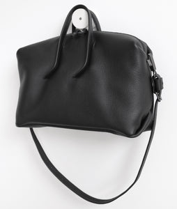 Wednesday frrry bag. black. handle attachment. folded corners. shoulder strap.