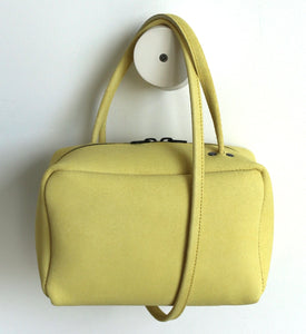 Tuesday. small frrry bag. shoulder bag. hand-held-bag. evening bag. thin strap. zipper closure. yellow colour.