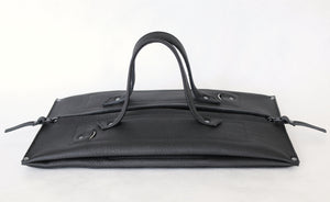 pumpkin frrry. foldable bag. black leather. flat pack. rectangle.