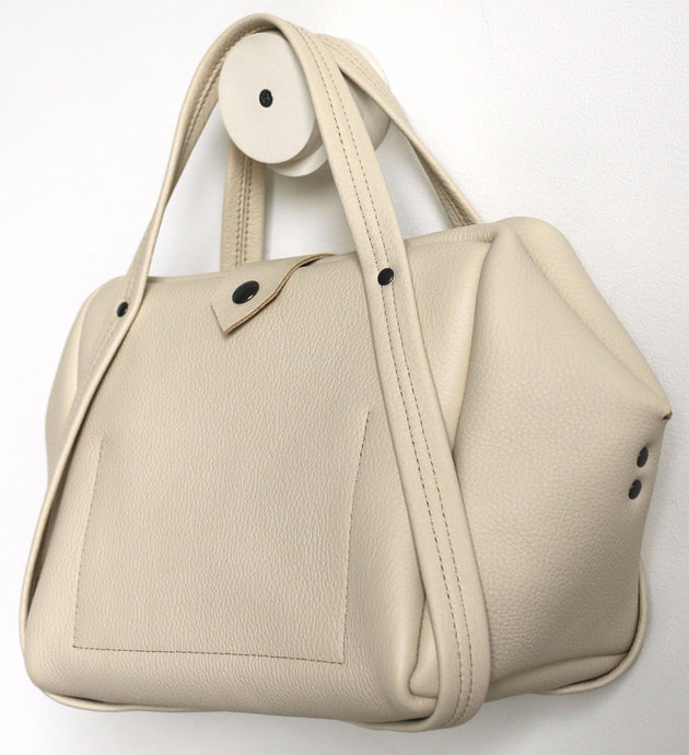 plum frrry bag. champagne colour. folded corners.