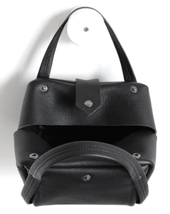 bes frrry bag black cute small handbag. open. top-view. view from above. button closure. snap. handles. strong