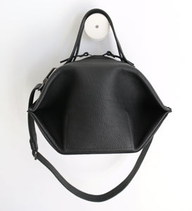 pumpkin frrry. foldable bag. black leather. round shape. plump. zipper closure.