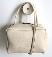 Load image into Gallery viewer, Tuesday. small frrry bag. shoulder bag. hand-held-bag. evening bag. thin strap. zipper closure. Champagne colour.