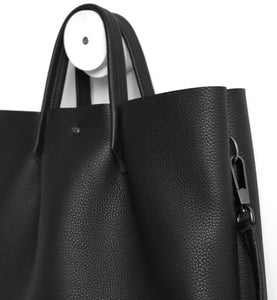 Monday frrry tote bag. shoulder strap.  black. detail view. snap hook. ring .