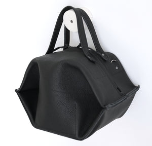 pumpkin frrry. foldable bag. black leather. side view. shoulder strap.