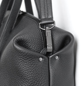 Wednesday frrry bag. black. chrome-free leather. detail. corner. snap hook.