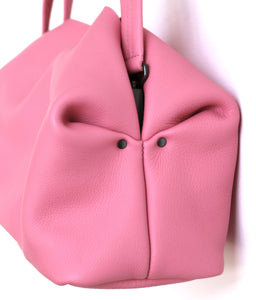 owl frrry bag leather. pink. side view. owl face. folded corners. construction.