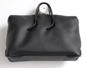 Wednesday frrry bag. black. chrome-free leather. bottom view.