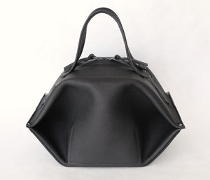 pumpkin frrry. foldable bag. black leather. zipper closure