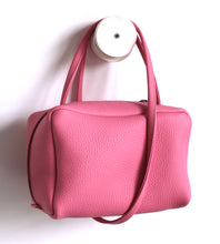 Load image into Gallery viewer, Tuesday. small frrry bag. shoulder bag. hand-held-bag. evening bag. thin strap. zipper closure. pink colour.