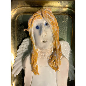 Ceramic guardian angels housed in a tobacco tin by mixed media artist Heather Tobias woman