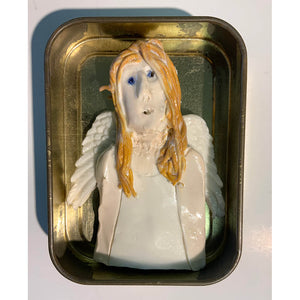 Ceramic guardian angels housed in a tobacco tin by mixed media artist Heather Tobias