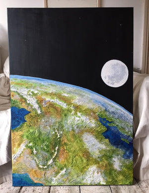 Above and Beyond a textural painting of Earth seen from space by Gill Hickman, this image shows the painting hung portrait view