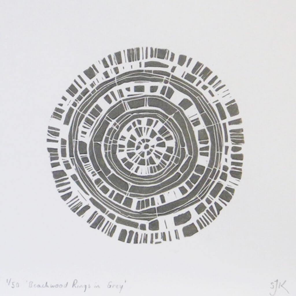 Hand printed linocut by artist Sarah Knight. Beachwood Rings is available in grey, in an optional navy blue frame.