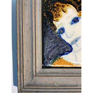 Blue Eyed Woman by mixed media figurative artist Heather Tobias oxide and glaze painted tile set in a wooden frame corner detail