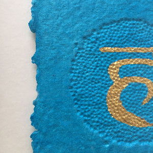 Close up of the blue section of Chakras by Gill Hickman Textural Artist, showing the  embossing effect and the gold leaf symbol