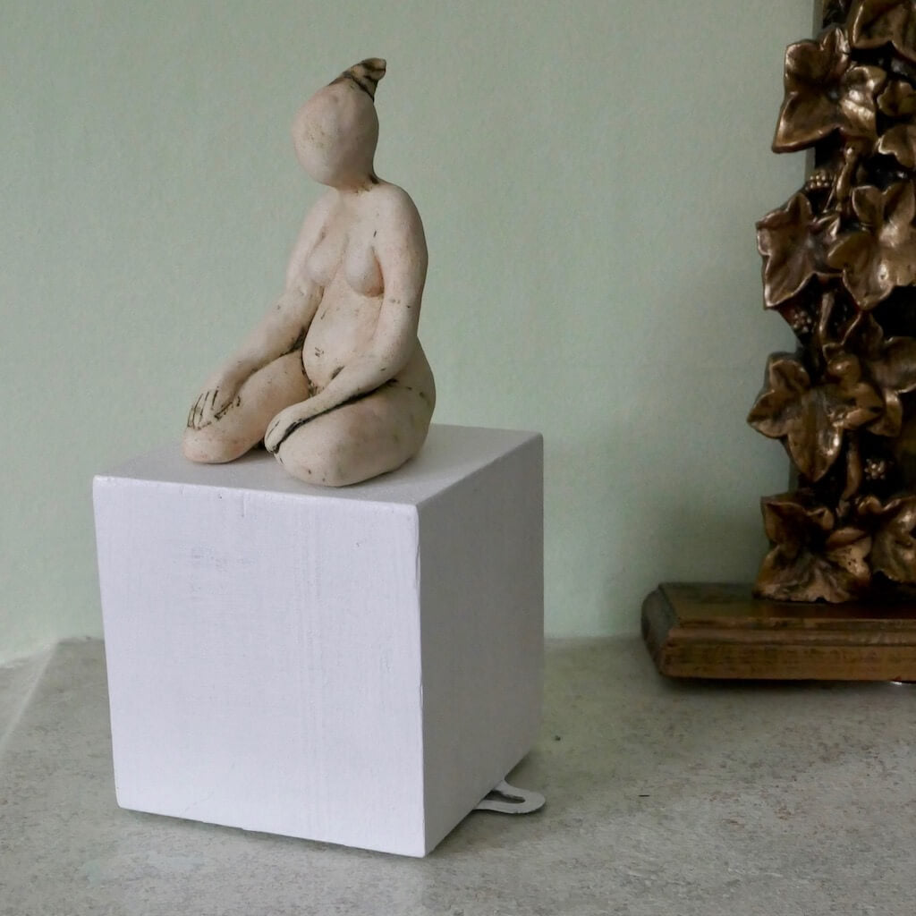 Figurine on a White Cube by Ruty Benjamini