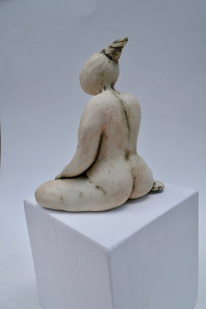 Figurine on a White Cube by Ruty Benjamini Back