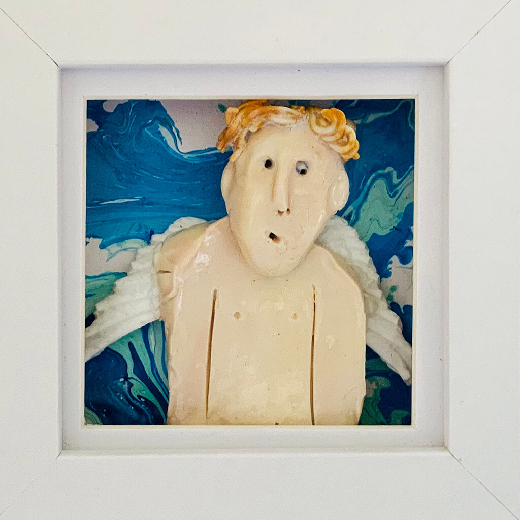 Guardian Angel 3 by Heather Tobias is a porcelain and underglazed celestial being on a marbled acrylic background in a light grey frame
