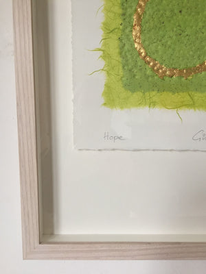 Hope original embossed collage in green with a circle in gold leaf by London textural artist Gill Hickman close up