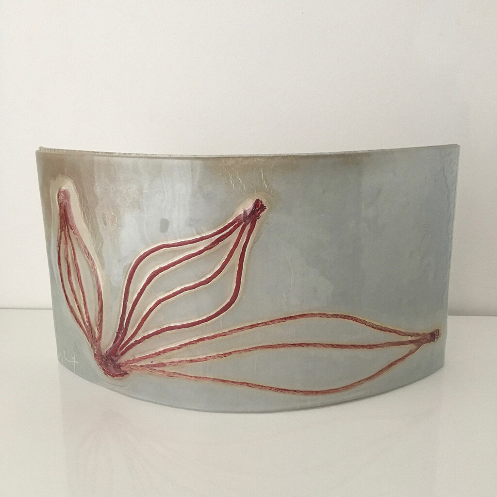Leaves, curved by Eryka Isaak Grey Glass Sculpture with brown leaf design