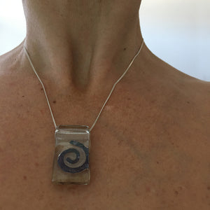 Spiral by Eryka Isaak glass pendant on sterling silver kerb chain necklace modelled