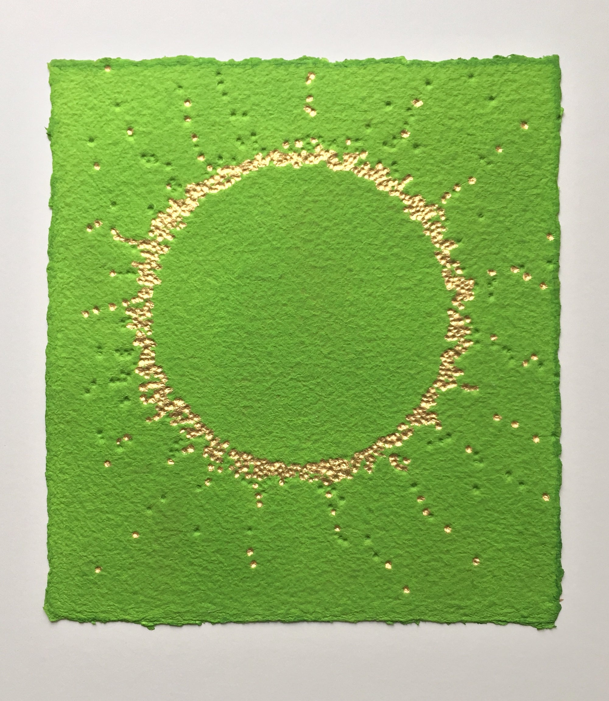 Suddenly it's spring , artwork by Gill Hickman, a deeply textured circle of gold leaf beams out from a vivid green background announcing, like a fanfare that spring has arrived.