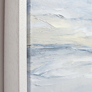 Tofino Seascape by Sarah Knight. An original semi-abstract oil seascape painted in shades of blue and grey framed in white wood close up