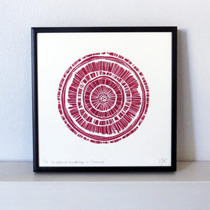 Hand printed linocut by artist Sarah Knight. Weathered Woodrings is available in either crimson or teal, both in an optional navy blue frame.