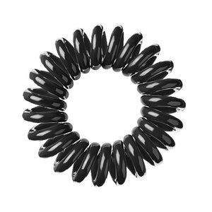 A black coloured plastic spiral circular hair bobble on a white background called a spirabobble.