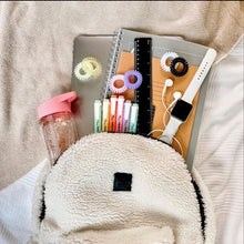 Load image into Gallery viewer, Fluffy rucksack with school contents showing including different coloured spirabobbles and a waterbottle and a laptop