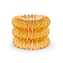Load image into Gallery viewer, A tower of 3 Tangerine Orange coloured hair bobbles called spirabobbles. A plastic spiral circular hair tie spira bobble.
