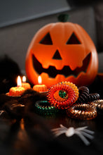 Load image into Gallery viewer, Halloween colours of SpiraBobble Hair Accessories SpiraBobbles with a pumpkin in the background