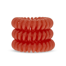 Load image into Gallery viewer, A tower of 3 bright oramge coloured hair bobbles called spirabobbles. A plastic spiral circular hair tie spira bobble.
