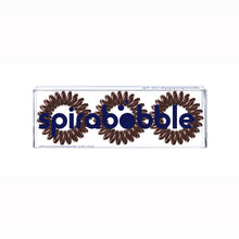 Load image into Gallery viewer, A flat transparent box of 3 brown sugar coloured hair accessories called spirabobbles