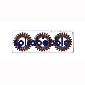 A flat transparent box of 3 brown sugar coloured hair accessories called spirabobbles