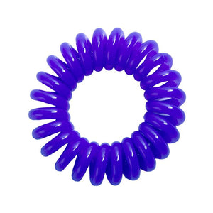 A solid purple coloured plastic spiral circular hair bobble on a white background called a spirabobble