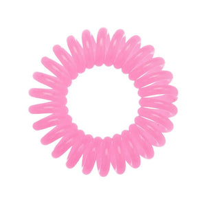 A candy pink coloured plastic spiral circular hair bobble on a white background called a spirabobble.