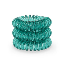 Load image into Gallery viewer, A tower of 3 serene green coloured hair bobbles called spirabobbles. A plastic spiral circular hair tie spira bobble.