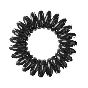 A black magic coloured plastic spiral circular hair bobble on a white background called a spirabobble