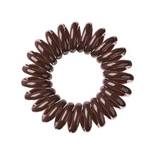 Load image into Gallery viewer, A brown sugar coloured plastic spiral circular hair bobble on a white background called a spirabobble.