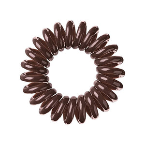 A brown sugar coloured plastic spiral circular hair bobble on a white background called a spirabobble.
