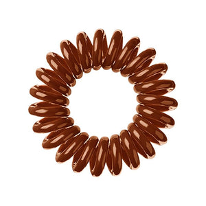 A cinnamon bun brown coloured plastic spiral circular hair bobble on a white background called a spirabobble.