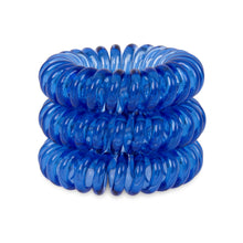 Load image into Gallery viewer, A tower of 3 clearest blue coloured hair bobbles called spirabobbles. A clear blue plastic spiral circular hair tie spira bobble.