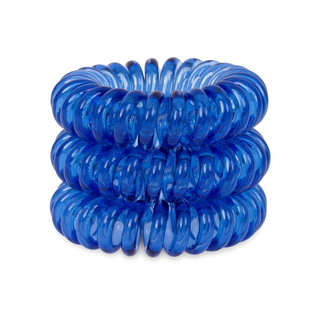 A tower of 3 clearest blue coloured hair bobbles called spirabobbles. A clear blue plastic spiral circular hair tie spira bobble.