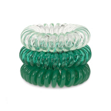 Load image into Gallery viewer, A tower of 3 clearly green coloured hair bobbles called spirabobbles. A clear and green plastic spiral circular hair tie spira bobble.