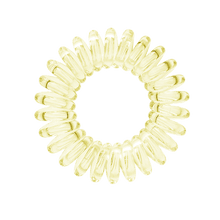 Load image into Gallery viewer, A light yellow coloured plastic spiral circular hair bobble on a white background called a spirabobble.